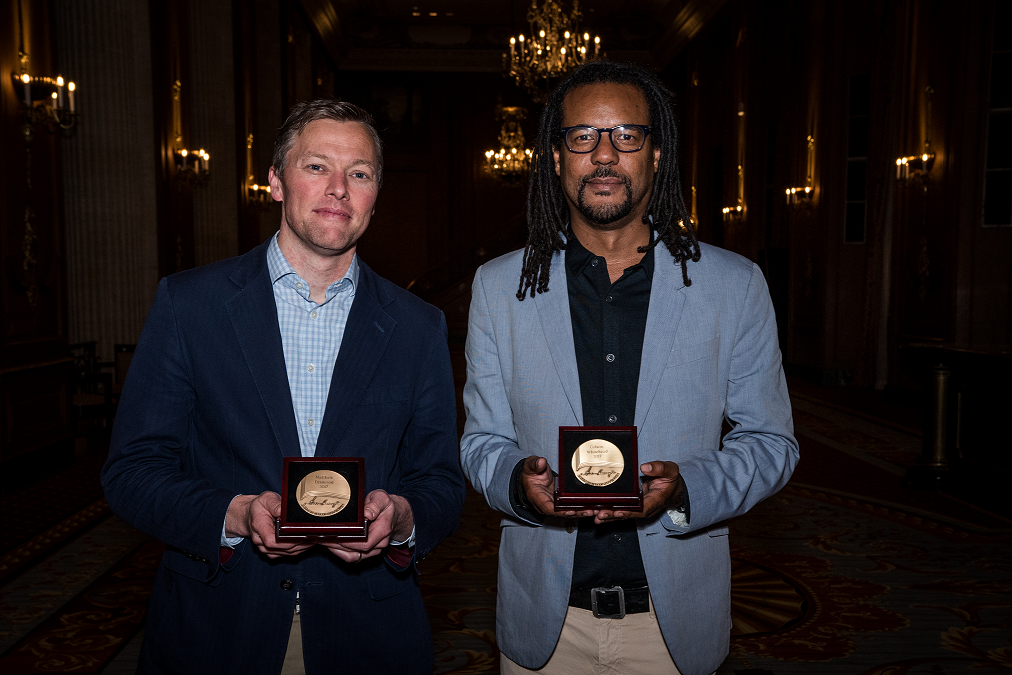 Colson Whitehead and Matthew Desmond holding their Carnegie Medals